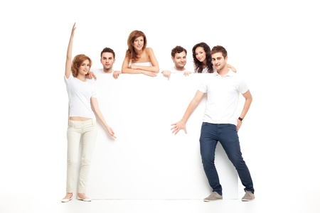 group of smiling friends recommending blank banner  photo