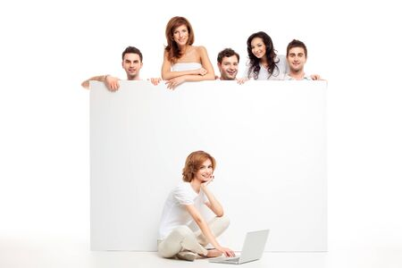 friends group showing blank banner woman laptop photo