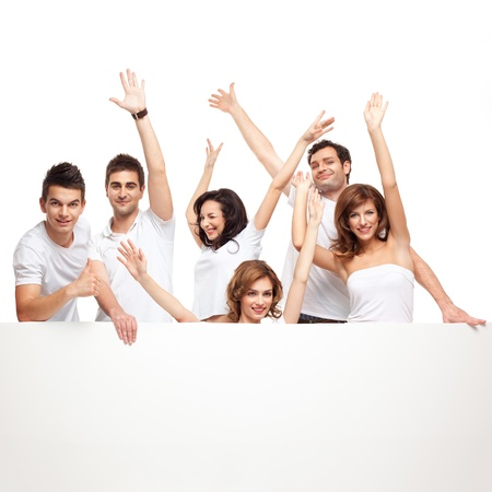 group of smiling friends excited over a white banner Stock Photo - 9881611