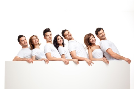 advertising woman: team of playful smiling people holding banner   Stock Photo