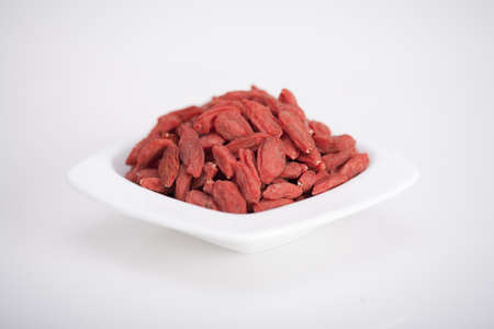 bowl full of healthy antioxidant goji berries  photo