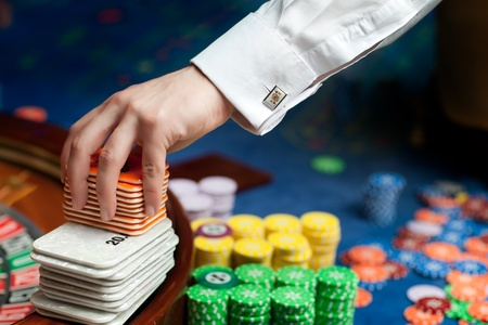 hand of professional casino dealer moving plastic cards Stock Photo - 9881743