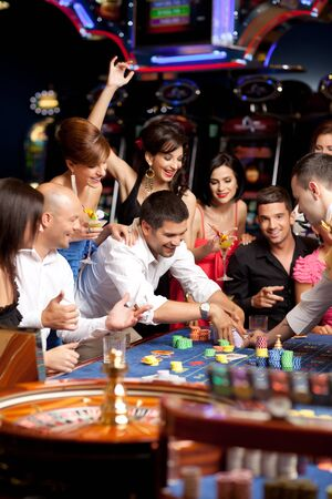 roulette player: young people exited over playing roulette Stock Photo