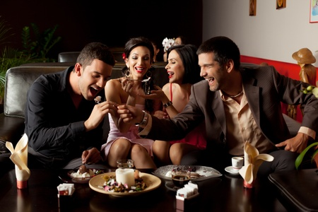 young couples changing roles, feeding ice-cream to each other Stock Photo - 9881709