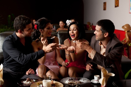 group of party lounge friends feeding young woman photo
