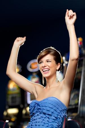 young woman playing celebrating arcade winning  Stock Photo