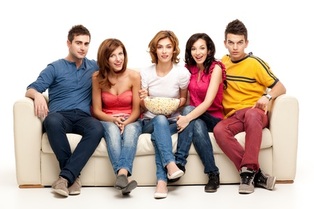 friends sitting on couch watching tv