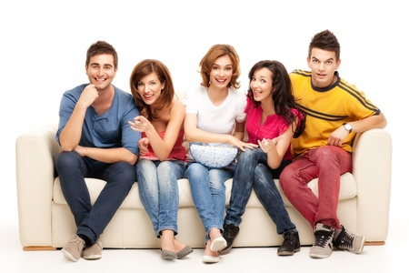 friends: friends sitting on couch laughing at comedy movie Stock Photo