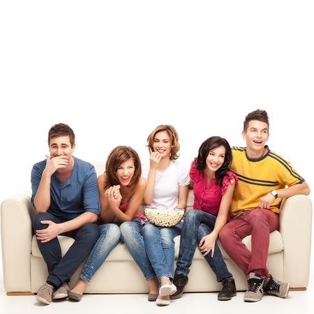 man couch: friends sitting on couch laughing hard at comedy movie