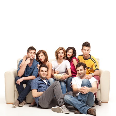 show home: casual friends sitting comfortable watching tv
