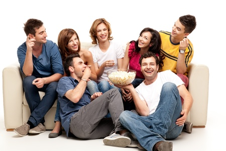 sofa television: friends sitting on couch laughing at comedy movie Stock Photo