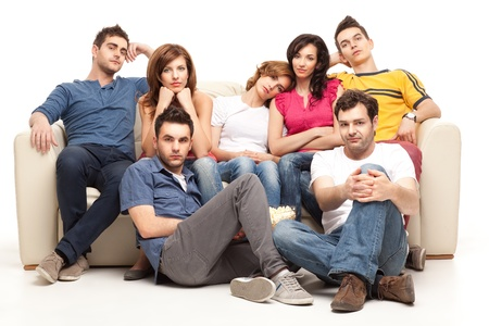 bored woman: young gathering of friends watching boring sad movie  Stock Photo