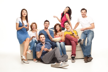 friends sitting on couch laughing at comedy movie Stock Photo - 9881720