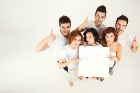 ad sign: team of casual young people holing blank banner
