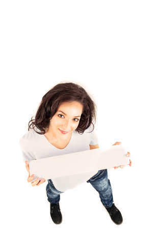 young casual brunette woman holding blank banner Stock Photo - 9881633