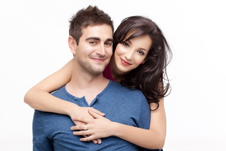 woman holding with love her boyfriend from behind, posing at camera Stock Photo
