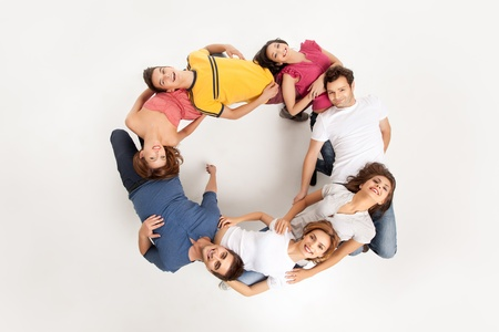 young group of pople standing in acircle holding each other Stock Photo - 9937516