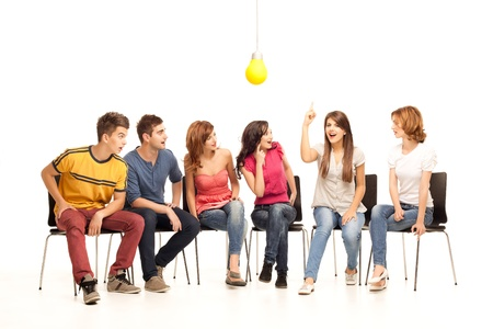 group of young people looking amazed at girl having an idea Stock Photo - 9937518