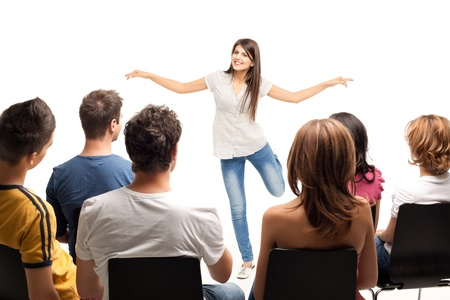 guessing: young woman standing in front of crowd gesturing  Stock Photo