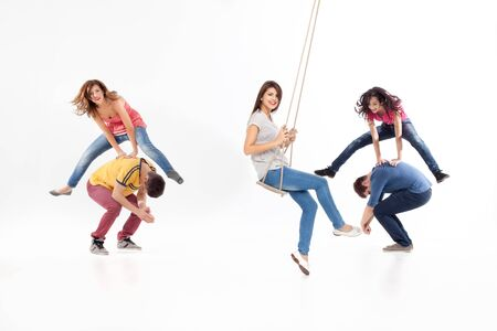 griping: friends jumping, swinging, playing, having fun Stock Photo
