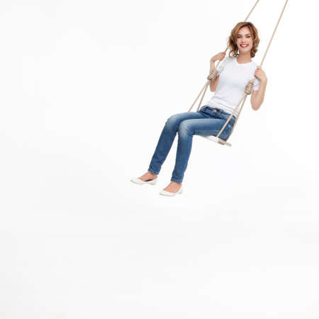 young woman swinging alone on a swing Stock Photo - 9937392