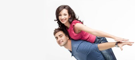 young playful involved couple posing as flying Stock Photo - 9937462