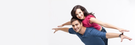 young playful involved couple posing as flying photo