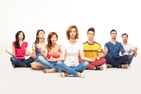 people siting in lotus position at yoga curse with calm expressions  photo