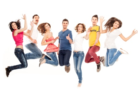 young group of casual, smiling people jumping photo