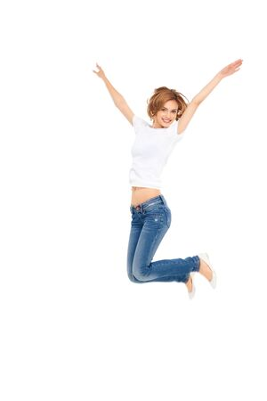 air jump: young casual woman jumping exited with hands in the air