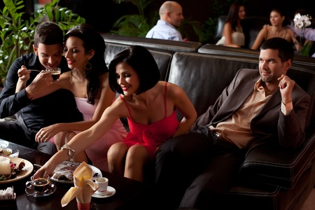 lounge bar: young couples sitting at the lunge area, drinking coffee, eating dessert