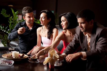 lounge bar: romantic glamourous couples sitting at coffee and dessert