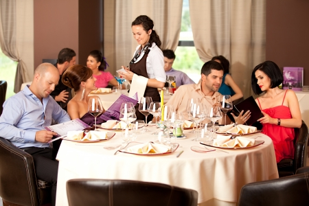 restaurant people: couples sitting at the restaurant table, ordering meal