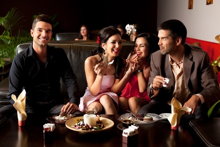young couples having fun over dessert and coffee