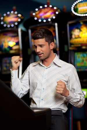 machine man: man just winning the big price at the slot machine