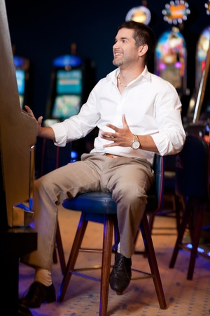 caucasian man playing the slot machine photo