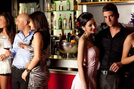 bar counters: young couples at bar counter having fun