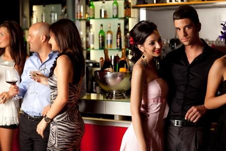bar counters: young couples at bar counter having fun