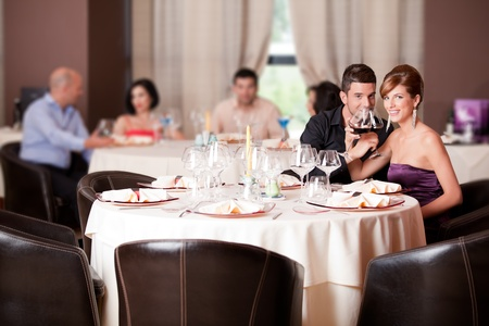 romantic young couple in restaurant date toast photo