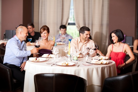happy young couples toasting restaurant table Stock Photo - 10297586