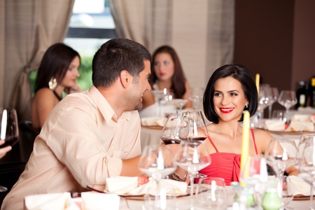 happy young couple toasting restaurant table Stock Photo - 10298272