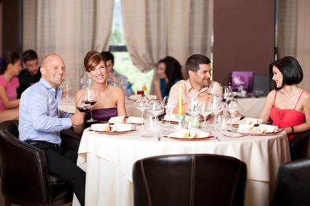 happy young couples talking restaurant table  Stock Photo - 10297724
