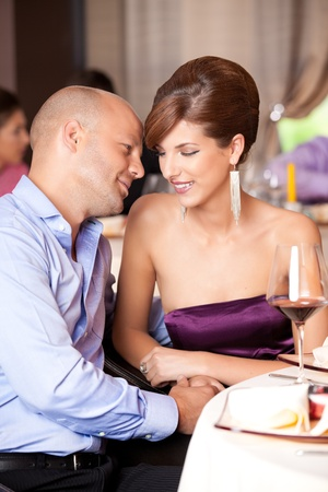 happy couple flirting at restaurant table photo