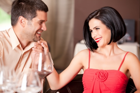 adult dating: happy couple flirting at restaurant table Stock Photo