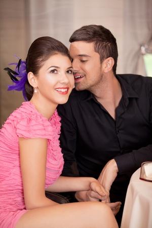 happy happy couple flirting at restaurant table photo