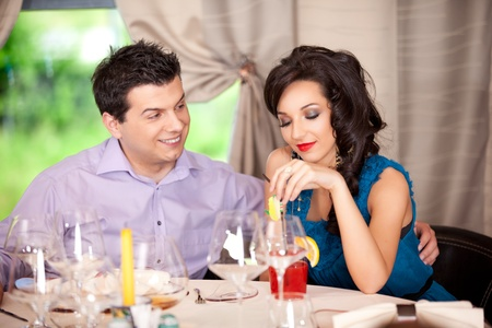 funny man flirting, woman borred restaurant table photo