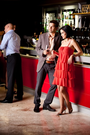 romantic evening with wine: young couple bar counter having drinks Stock Photo