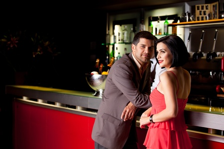 bar counters: young couple bar counter having drinks Stock Photo