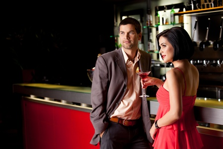 young couple bar counter having drinks Stock Photo