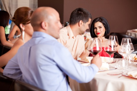 romantic young couple at restaurant table photo